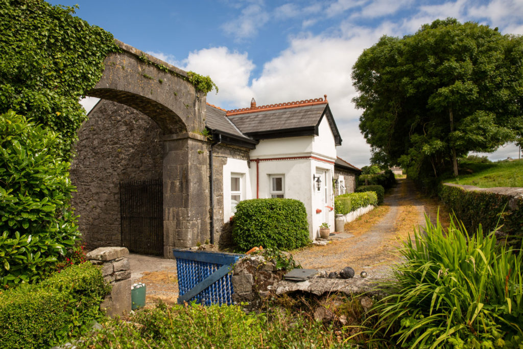 Newbrook House Mayo property photography of a traditional Irish farmhouse, country lane and blue gate. Image by Sean Flynn, The Commercial Photographer
