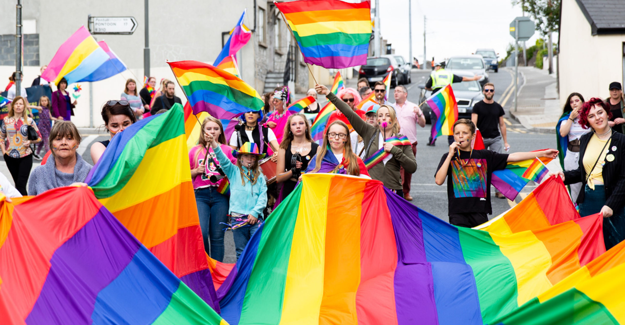 Mayo Pride Parade rainbow flag carried by members of Mayo's LGBT community at the Pride celebrations - PR photography by Sean Flynn, The Commercial Photographer Ireland