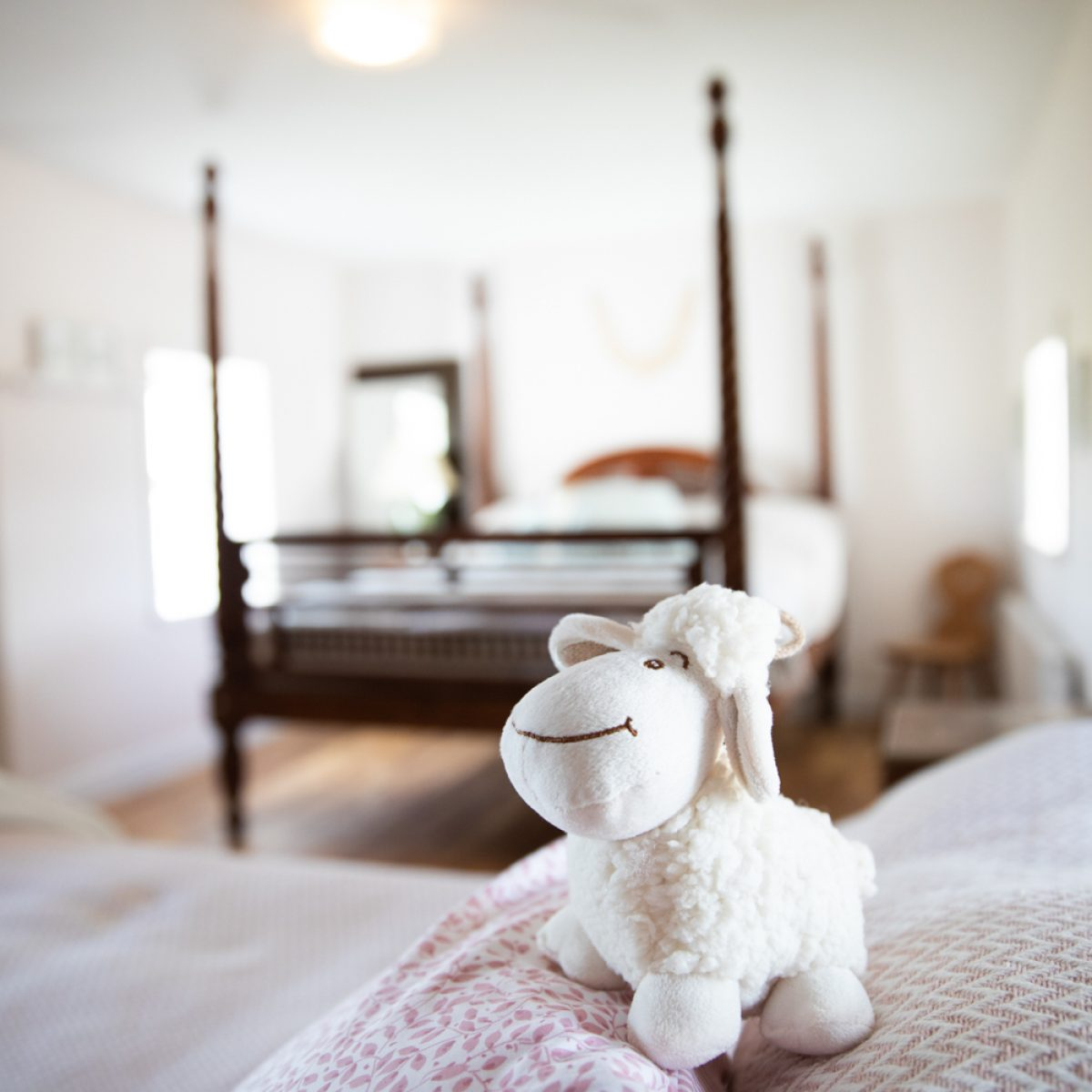 Newbrook House Mayo property photography interiors photography of soft toy sheep with four poster bed in background . Image by Sean Flynn, The Commercial Photographer